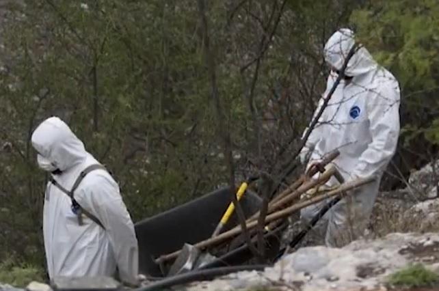 Buscan a sus familiares entre cuerpos de fosas clandestinas (Puebla)
