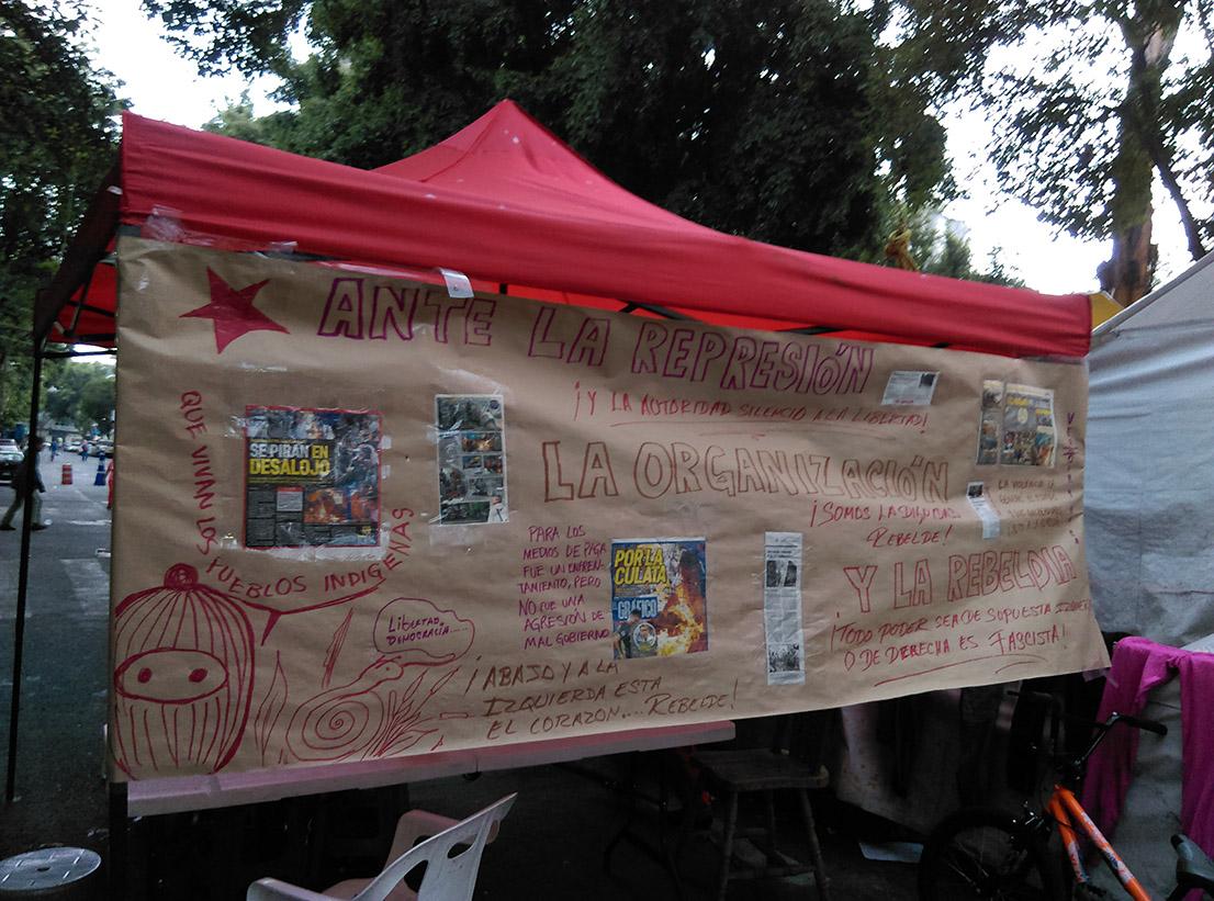 En la calle Roma #18, la policía ataca y roba a indígenas otomíes de las redes de apoyo al CIG (Ciudad de México)