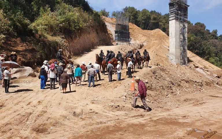 Otorgan suspensión de la autopista Toluca-Naucalpan y vuelven enfrentamientos (Estado de México)